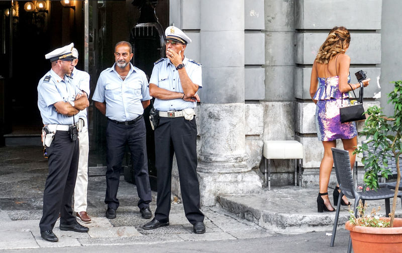 don´t look! Palermo, Italy Street Street Photography Streetphotography Police Palermo Sicily Flirting Beauty Looking At Camera Smiling Young Women Uniform Profile View Standing Travel Teamwork Sexygirl