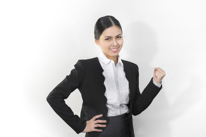 Businesswoman is smile Asian  Beatiful Girl Businesswoman Casual Clothing Confidence  Front View Girl Leisure Activity Lifestyles Portrait Smile Standing Suit Work