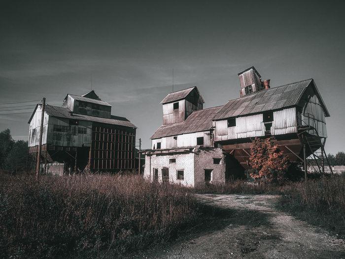 Old building in field against sky
