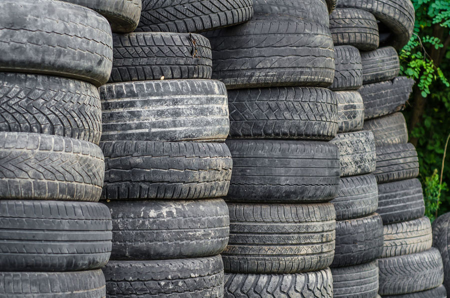 Old used car tires stacked in stacks Architecture Arrangement Backgrounds Black Color Close-up Day Focus On Foreground Full Frame In A Row Large Group Of Objects Nature No People Old Outdoors Pattern Repetition Rubber Stack Tire Wheel