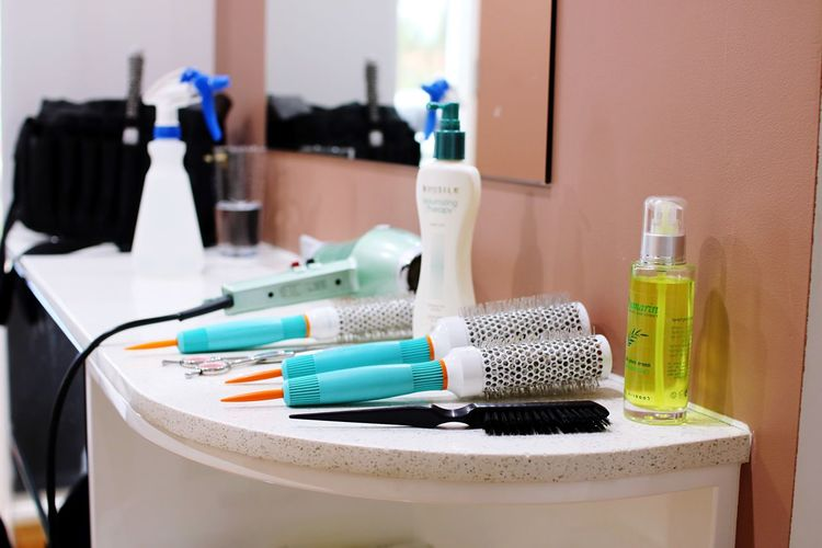 Combs with beauty products on table