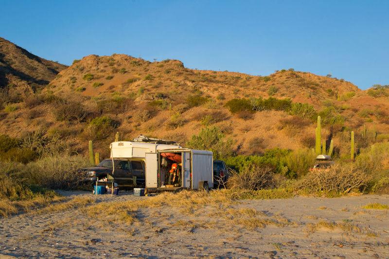 Motor home against mountain at beach