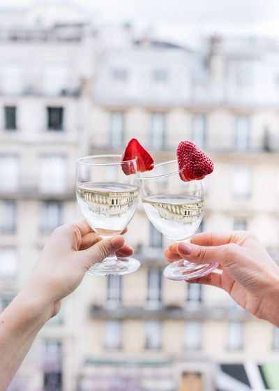 Close-Up Of Women Toasting Drinks Outdoors
