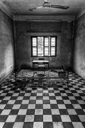 Civil War Genocide Torture Abandoned Absence Architecture Building Built Structure Ceiling Checked Pattern Day Domestic Room Empty Flooring Home Interior Indoors  No People Old Pattern Prison Tile Tiled Floor Tuol Sleng Genocide Museum Wall - Building Feature Window