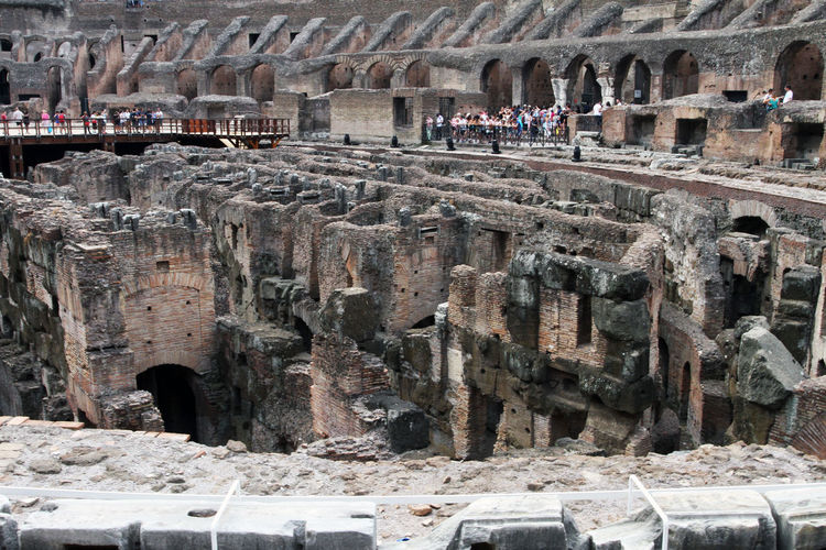 Amphitheater Ancient Ancient Civilization Arch Archaeology Architectural Column Architecture Building Exterior Built Structure Colosseum Day Group Of People History Incidental People Men Old Ruin Outdoors Ruined The Past Tourism Tourist Travel Travel Destinations