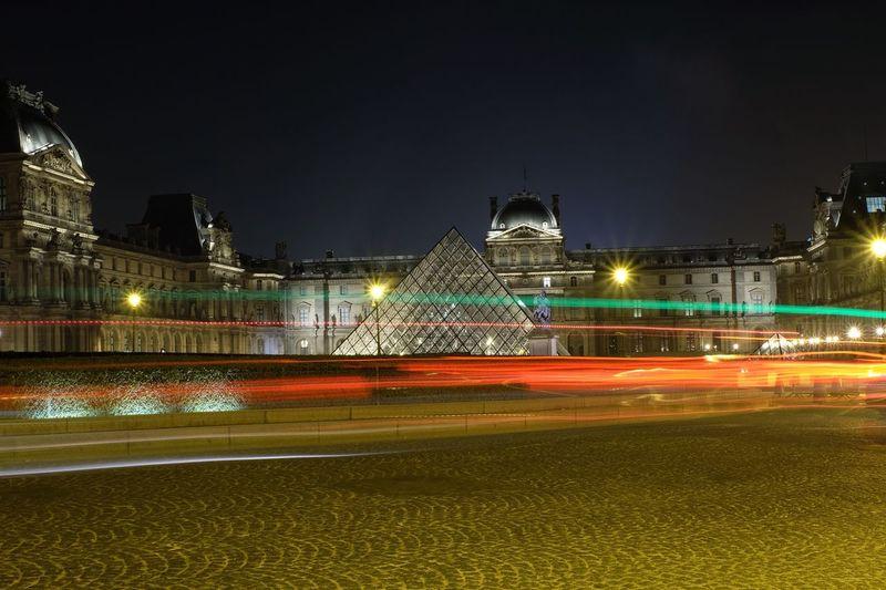 Illuminated light trails against sky at night
