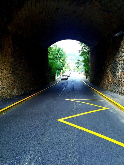 TakeoverContrast Road Marking Road Built Structure Tunnel Architecture Connection Arch Day Passing double yellow line Transportation The Way Forward Car Mode Of Transport Land Vehicle Diminishing Perspective Vanishing Point Long Green Color