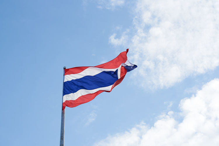Low angle view of thai flag against sky
