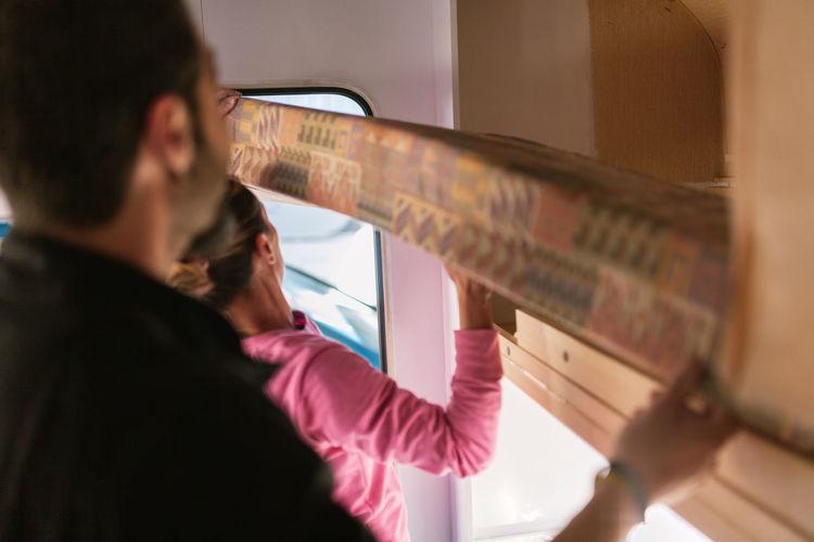 Couple adjusting seat in camper trailer