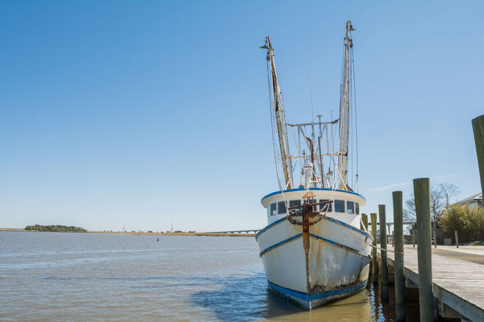 Shrimping boat tied up to dock Fishing Fishing Boat Gulf Coast Gulf Of Mexico Ocean Shrimp Boat Shrimping Vintage