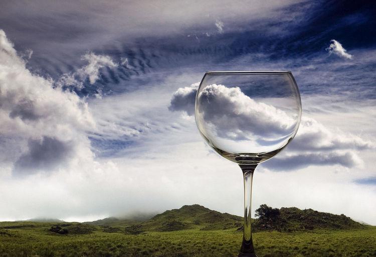 White wine in glass against sky