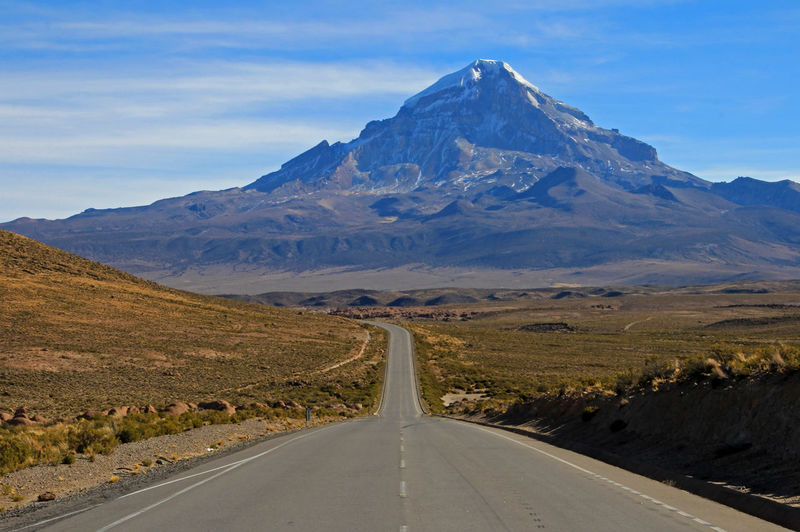 Sajama mountain in the National Park, Bolivia, near boarder to Chile Sajama Sajama National Park Andes Volcano Bolivia South America Peak Travel Tourism Scenery Parque  National Andean Bolivian Mountain Mountain Range Mountains Chile Oruro Altiplano Transportation Road Highway Snowcapped Snowcovered