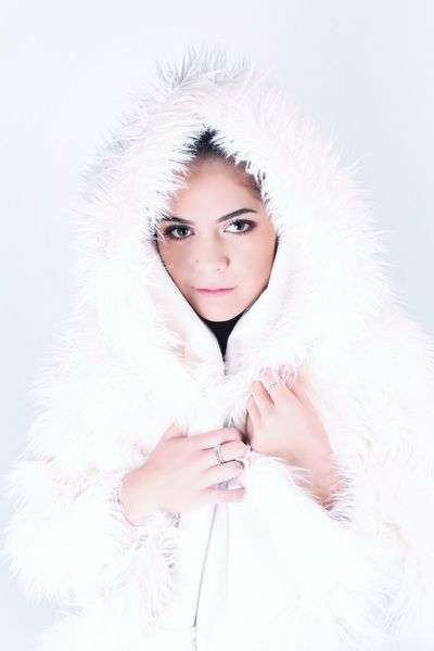 Looking At Camera Portrait Fur One Person White Color Fashion Studio Shot Lifestyles Winter Young Adult EyeEm Selects Beauty Beautiful People Real People Beautiful Woman White Background Warm Clothing Fashion Model Young Women Indoors  Close-up Day People