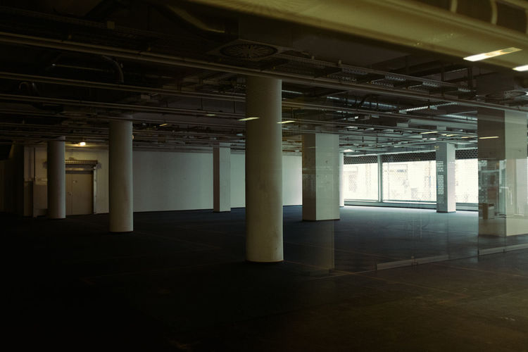 Open Space Architectural Column Architecture Indoors  Empty No People Built Structure Ceiling Absence Flooring Building Domestic Room Day Parking Lot Illuminated Abandoned In A Row Pipe - Tube Business Construction Industry Parking Garage Colonnade