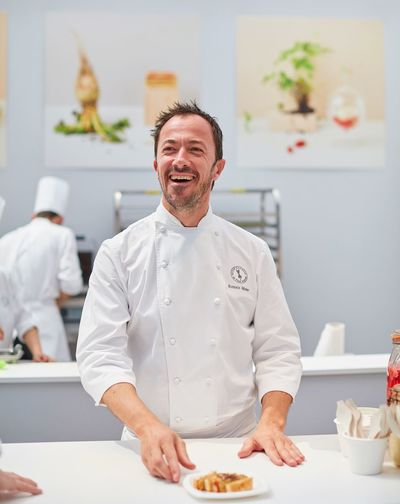 Romain Meder - Plaza athénée Romain Meder Indoors  Food Adult Males  Smiling Occupation Food And Drink Happiness Kitchen Business Commercial Kitchen Uniform