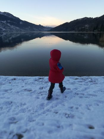 #throwing #snowball #red #reflection #Lake Lake One Person Winter People Childhood Children Only Discovery Exploration Child Snow Outdoor Pursuit Nature Cold Temperature One Girl Only Outdoors Water Adventure Full Length