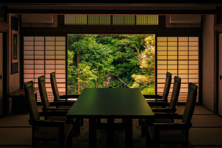 Office space -- Japanese garden style Business Stories Japan Japanese Garden Architecture Built Structure Business Time Chair Conference Room Contrast Of Nature & Humanity Day Education Empty Growth Indoors  Kyoto Nature Business No People Table Tree Window Window To The World