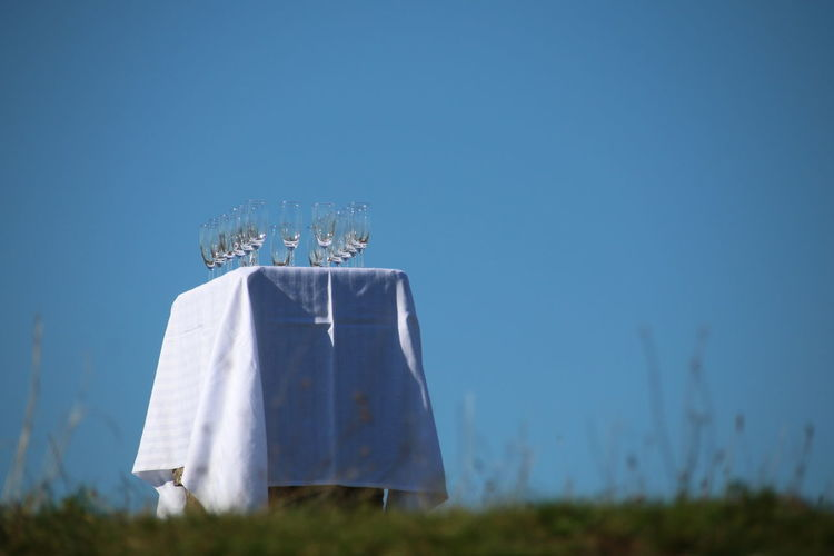 Champagne Reception Reception Outdoor Reception Champagne Glasses White Tablecloth Outdoors Blue Sky Grass Nature Sky Blue No People Close-up Day Crafted Beauty