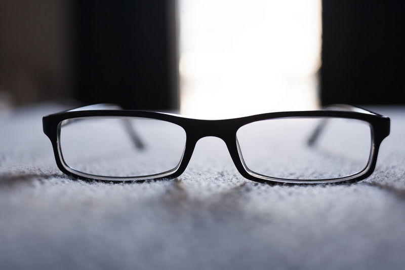 Close-up of eyeglasses on rug at home