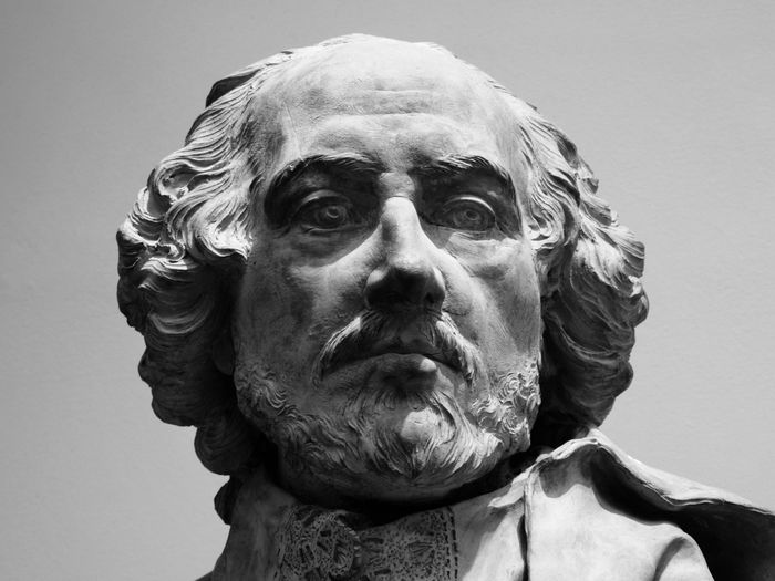 Close-up portrait of statue against gray background