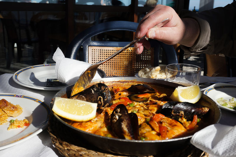 eating paella at a restaurant Paellas Paella Spanish Food Food Food And Drink Foodphotography Human Body Part Human Hand Human Hand Plate Seafood Gourmet Crustacean Close-up Food And Drink Shrimp Rice Dish Served Boiled Prawn Mussel Healthy Food