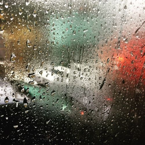Rain Wet Window Drop Glass - Material Transparent Water Weather Rainy Season RainDrop Indoors  Backgrounds Condensation No People Close-up Land Vehicle Looking Through Window Full Frame Day Car