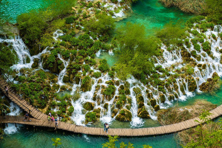 Beauty In Nature Day Flowing Water Green Color Growth Idyllic Lake Lush Foliage Mountain Nature No People Non-urban Scene Outdoors Plant Plitvice National Park Politic Lakes National Park Rock - Object Rock Formation Scenics Tranquil Scene Tranquility Tree Turquoise Colored Water Waterfalls