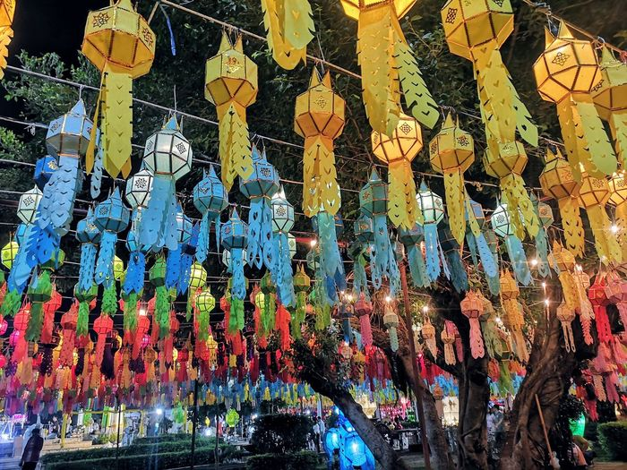 Low angle view of illuminated lanterns hanging in market