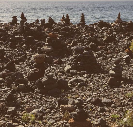 Art of stone balance, piles of stones on the beach. Tenerife, Canary Islands. Spain Atlantic Ocean Canary Islands Coastline SPAIN Tourist Attraction  Arrangement Art Balance Beach Coast Coastal Feature Concept Harmony Heap Of Stones Pebble Stones Pile Sculptures Sea Seaside Stack Of Stones Stacked Stones Stones Tenerife Tenerife Island Volcanic