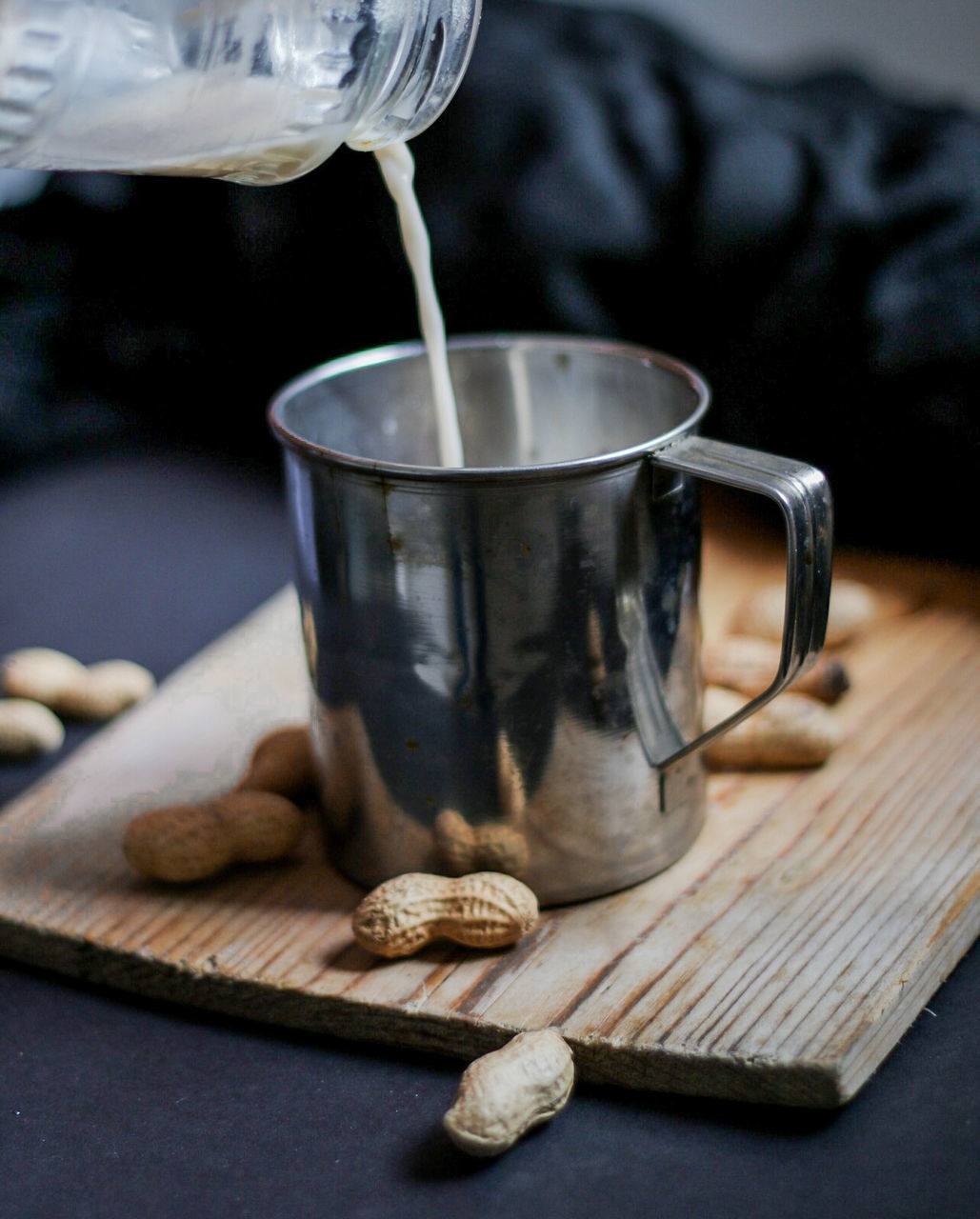 food and drink, refreshment, drink, table, indoors, cup, close-up, wood - material, focus on foreground, food, kitchen utensil, freshness, pouring, mug, no people, still life, hot drink, eating utensil, tea, glass, non-alcoholic beverage, tea cup