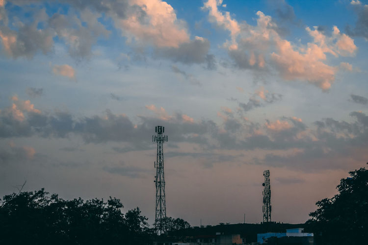 Sky Cloud - Sky Architecture Built Structure Low Angle View Nature Technology Tree Sunset No People Plant Silhouette Communication Building Exterior Outdoors Industry Tower Connection Construction Industry Beauty In Nature Global Communications