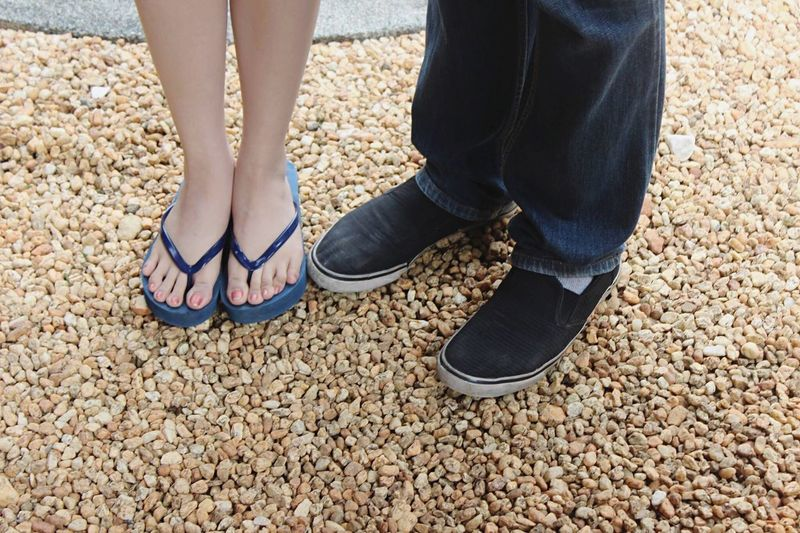 Couple feet😬 EyeEm Best Shots Human Limb Human Body Part Human Leg Low Section Standing Shoe Limb Human Foot Pebble Day Close-up Adults Only Togetherness People Outdoors Adult Flip-flop Simple Photography Eyeem Philippines EyeEm Gallery Eyeemphotography Couple Lovers Iphonephotography Love Yourself