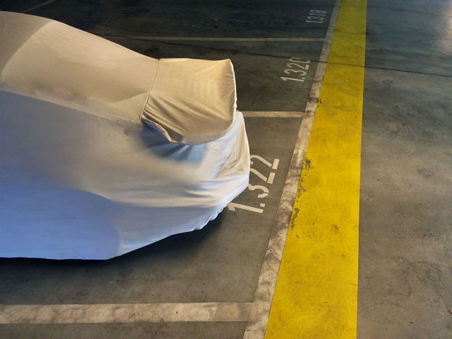 car in parking position is covered Asphalt Auto Automobile Car Coverage Covered Garage Hidden Hide Markings Number Numbers Parking Parking Area Parking Garage Parking Lot Parking Place Parking Places Parkingarea Parkinggarage Parkinglot Protected Road Marking Tarpaulin Vehicle