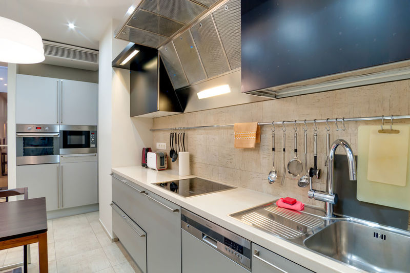 Home Domestic Kitchen Domestic Room Kitchen Indoors  Household Equipment Modern Home Interior Appliance Cabinet Furniture Sink No People Kitchen Counter Stove Architecture Oven Illuminated Lighting Equipment Faucet Flooring Steel Exhaust Fan Luxury Clean