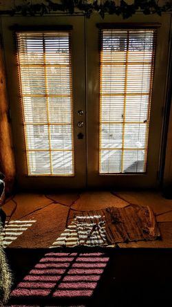 Interior Views Early Morning Light And Shadow Inside View Light Shadow French Doors Blinds Shadows Warmth Squares Cozy Windows Window Pane Sunlight Sunlight And Shadow Natural Light Rug Rock Floor Textures And Surfaces House Door House Design