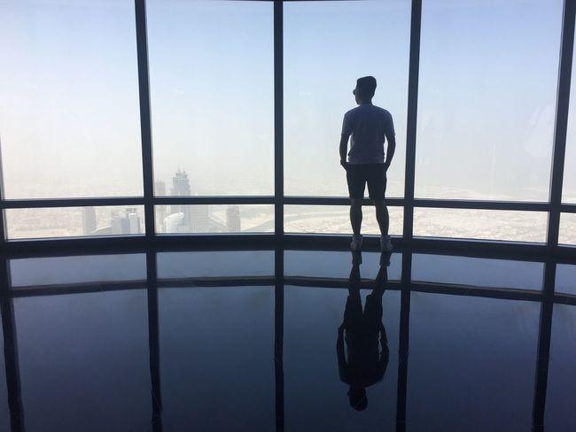 Unspoken thoughts. Chadventurestories Shadow Silhouette Photography Reflection Mirror Glass Shiny Floor Sky And Clouds Skyscraper EyeEmNewHere EyeEm Selects EyeEm EyeEm Best Shots EyeEmBestPics EyeEm Gallery Eyeem Market Photo Creativity Modern Architecture Dubai Culture Alone