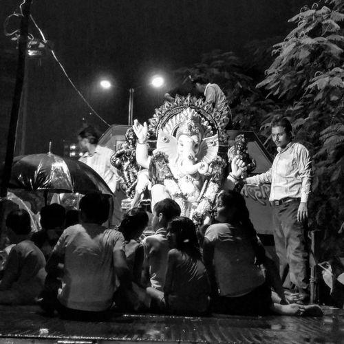 Rain isnt going to deter these kids from celebrating GaneshChaturthi ..they sit at LordGanesha's feet, drenched as they send him off.. Blackandwhite Festivemood Mumbai Oneplustwocamera Eeyem Mumbai