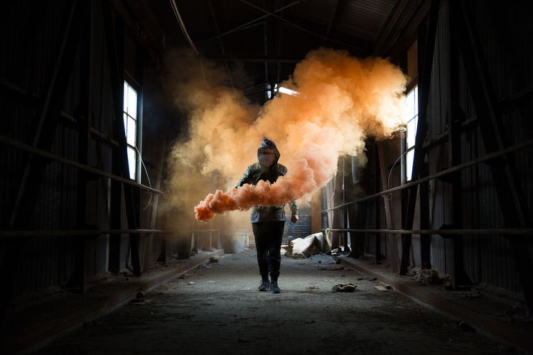 Danger Day Destruction Full Length Holding Indoors  Men One Person People Real People Riot Smoke - Physical Structure