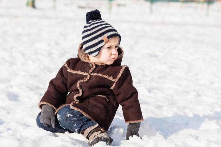 Full length of cute girl in snow