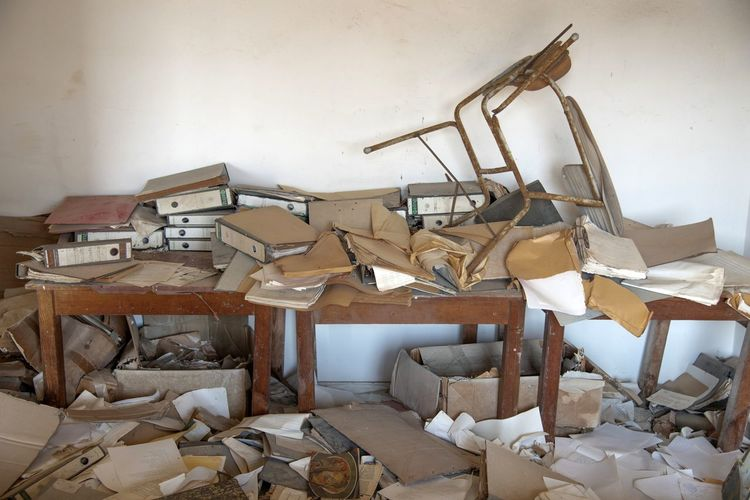 Chaos Office Office Chaos Chaos At Work FilesFolder Indoors  Large Group Of Objects Chair Seat No People Wall - Building Feature Furniture Old Wood - Material White Color Messy Stack Obsolete Abundance Damaged Abandoned Table Still Life Day Architecture Deterioration