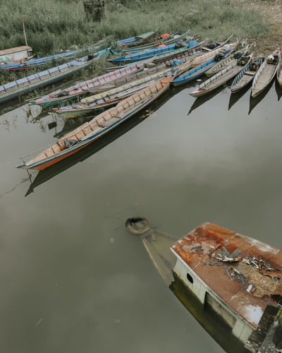 High angle view of fishing boats moored at harbor