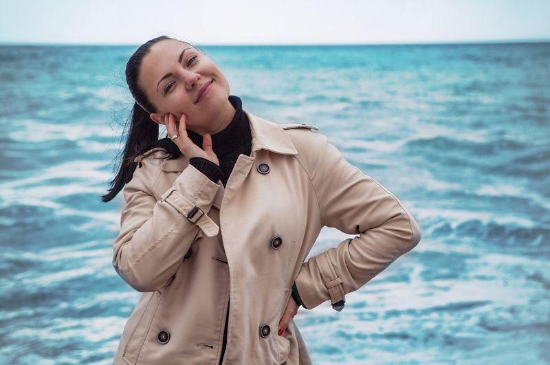 Portrait Of Beautiful Woman Against Sea