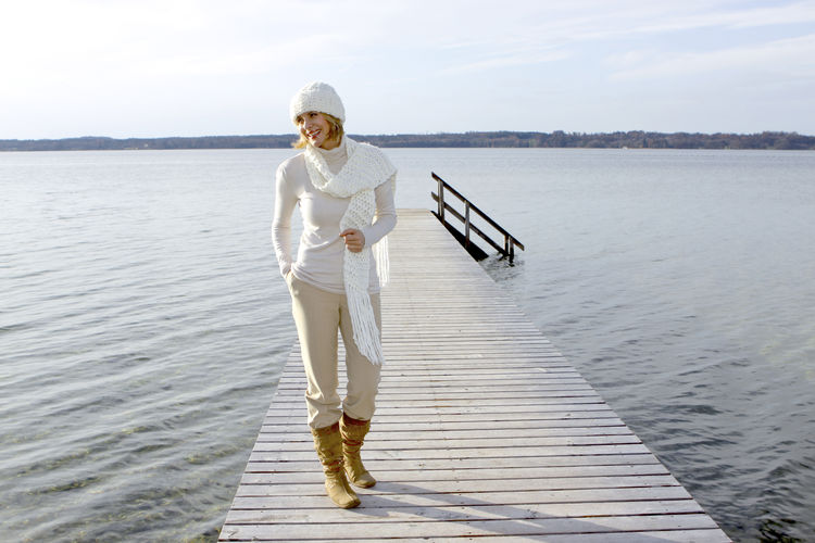 Blonde middle-aged woman on an autumn walk at the lake, portrait Autumn Walk Adult Day Full Length Lake Lakeside Leisure Leisure Activity Lifestyles Mature Adult Middle Aged Nature One Person One Woman Only Outdoors People Research Scientist Smiling Standing Water Women Young Adult