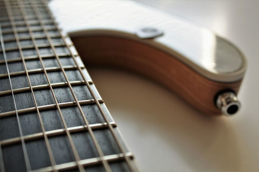 Arts Culture And Entertainment Classical Music Close-up Day Fretboard Guitar Indoors  Music Musical Equipment Musical Instrument Musical Instrument String No People Pick Plectrum String Instrument Wood - Material Woodwind Instrument