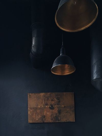 vintage signboard with an inscription on the dark blue wall Interior Design Design Lamps Taken On Mobile Device Dark Colors Interior Design Coffee Time Coffee Dark Blue Singboard Copy Space Indoors  No People Still Life Hanging High Angle View Black Background Glass - Material Antique Old Dark Metal Retro Styled Time