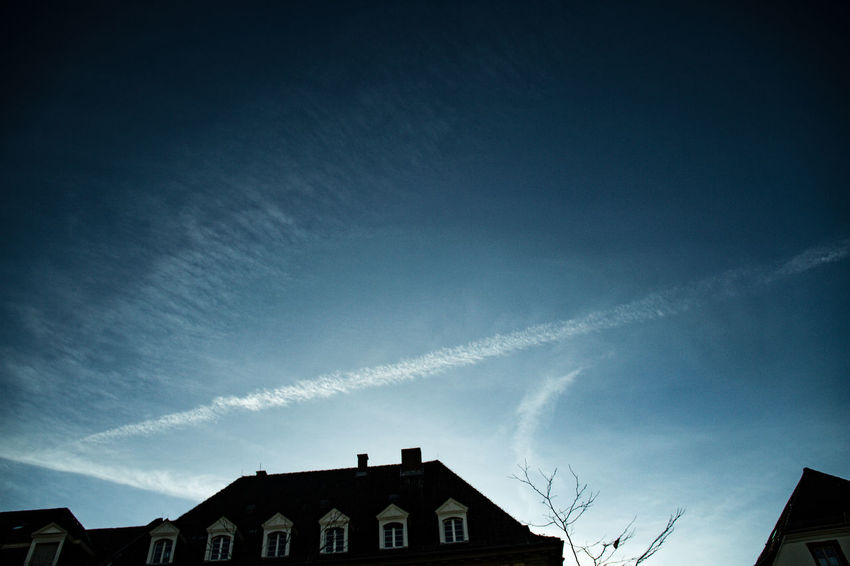 Architecture Building Exterior Built Structure Contrail Day Flyaway House Low Angle View Nature No People Outdoors Sky Vapor Trail