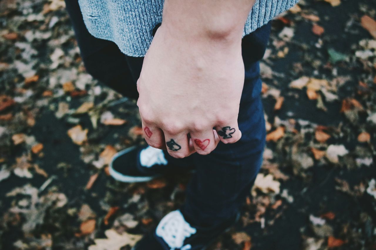 Close-up of fingers with tattoo