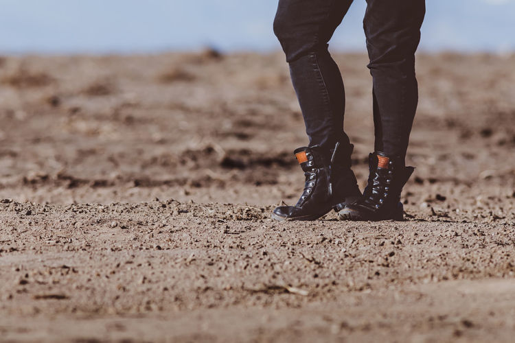 Low Section One Person Human Leg Shoe Real People Body Part Land Human Body Part Selective Focus Standing Day Sand Lifestyles Nature Leisure Activity Outdoors Human Foot Adult Walking Jeans Human Limb Surface Level