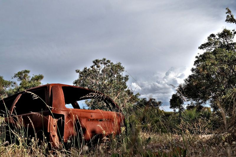 rusted wreck Cloud - Sky Outdoors Rusty Metal Rusty Car Vehicle Wrecked Wrecked Car Abandoned Left To Rot And Ruin Bush