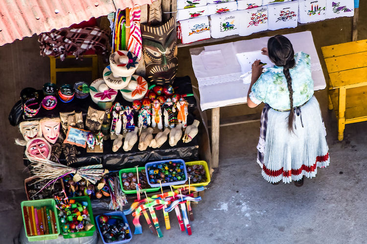 An Indigeous Woman Selling Souvenirs at Janitzio Island, Michoacan, Mexico Janitzio Market Merchant Mexico Tarascon-sur-Ariege Childhood Choice Craft Day For Sale Indigenous  Indigenous People Indoors  Large Group Of Objects Michoacan Multi Colored One Person People Real People Retail  Selling Stall Variation